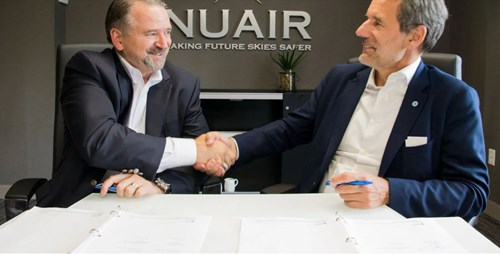 "Major General Marke F. ""Hoot"" Gibson (ret), chief executive officer of the NUAIR Alliance (left) signs partnership agreement with Marc Kegelaers, CEO of Unifly (right)"